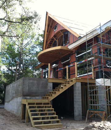 the cantilevered master balcony and marsh elevation
